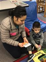 Parent reading with child.